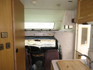 Looking toward the front - the bed in the cab-over.  There's a nice sturdy ladder for access.