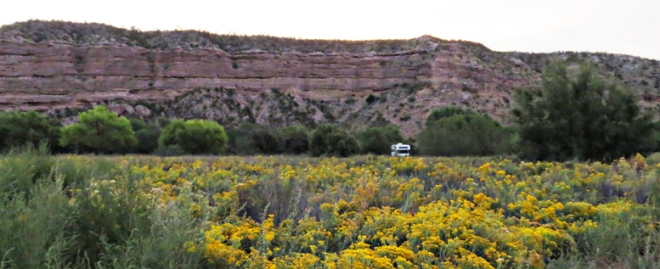 View of the RV and cliffs from the field.